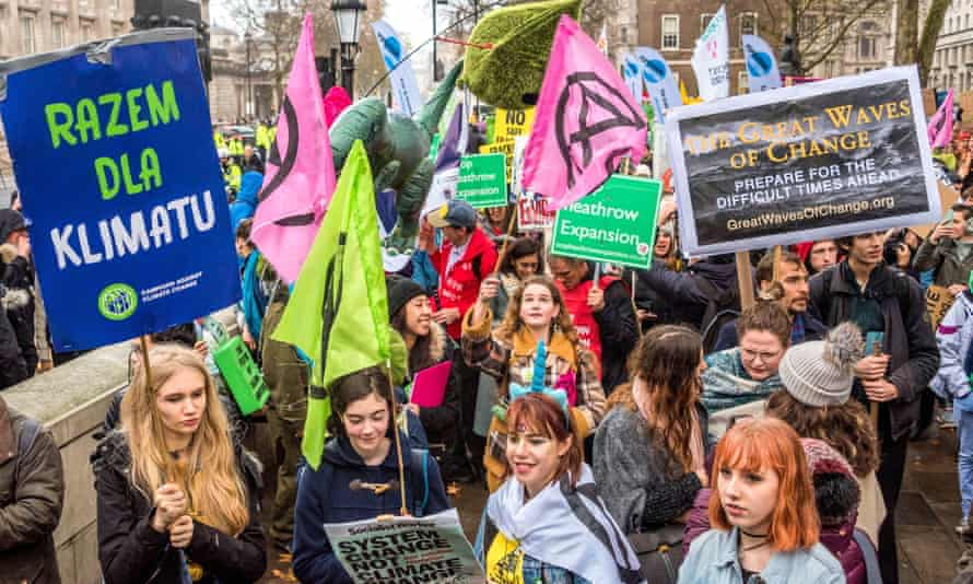 Extinction Rebellion march with other groups to at a climate justice protest in London, 1 Dec 2018.