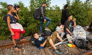 The Hassanein family rests on the railway line that is used as a crossing point from Serbia into Hungary