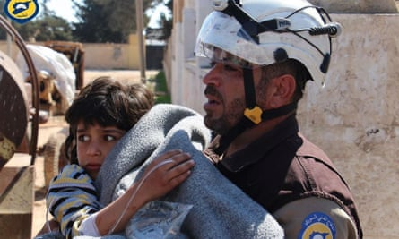 A Syria Civil Defence volunteer helps a victim of the suspected chemical attack in Idlib province.