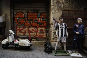 Statuettes of Juventus' Cristiano Ronaldo, left, and the team's former manager Carlo Ancelotti on sale in Naples, Italy