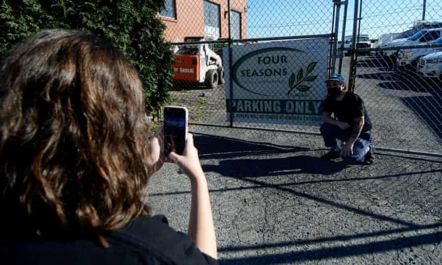 Philadelphians take pictures outside Four Seasons Total Landscaping on 9 November.