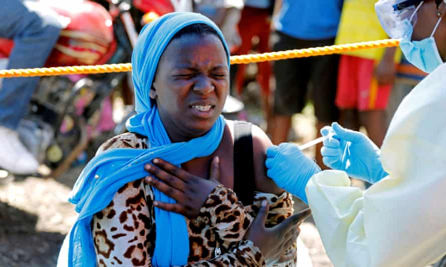 A woman is injected with the Ebola vaccine in Goma, the Democratic Republic of the Congo.