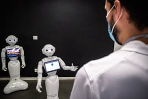 Pepper robots are demonstrated at SoftBank Robotics in Paris, France. The robots can detect whether people are wearing face masks and, if not, instruct them to do so