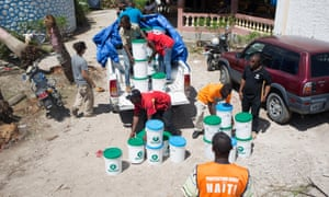 Members of a emergencies team of Oxfam delivering hygiene kits in 2016 to prevent the spread of Cholera and other diseases in the town of Camp Perrin, department Sud, Haiti, one of the most affected by hurricane Matthew.