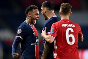 Neymar of Paris Saint-Germain and teammate Leandro Paredes celebrate their team's victory at full-time.