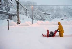 A man uses a snow blower to free a platform at the station in Berchtesgaden, Bavaria, Germany. Austria and southern Germany have had heavy snowfalls.