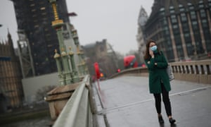 A woman crossing a largely empty Westminster bridge this morning.