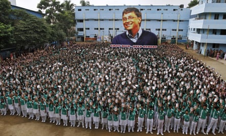 Chennai schoolchildren hold portraits of Bill Gates to mark his 60th birthday last month.