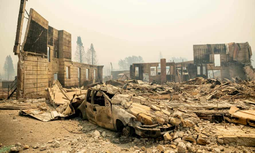 A destroyed hotel smolders during the Dixie fire in downtown Greenville, California.