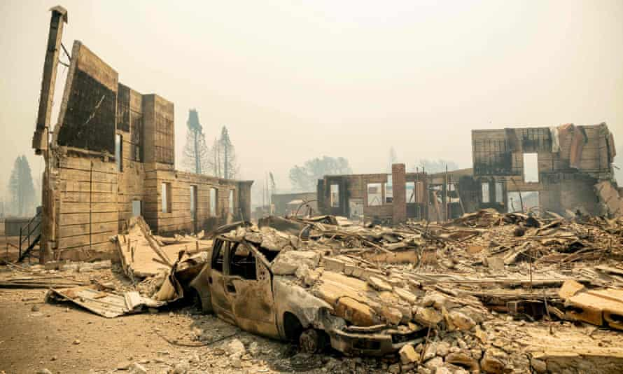 A destroyed hotel smolders during the Dixie fire in a ravaged downtown Greenville, California.