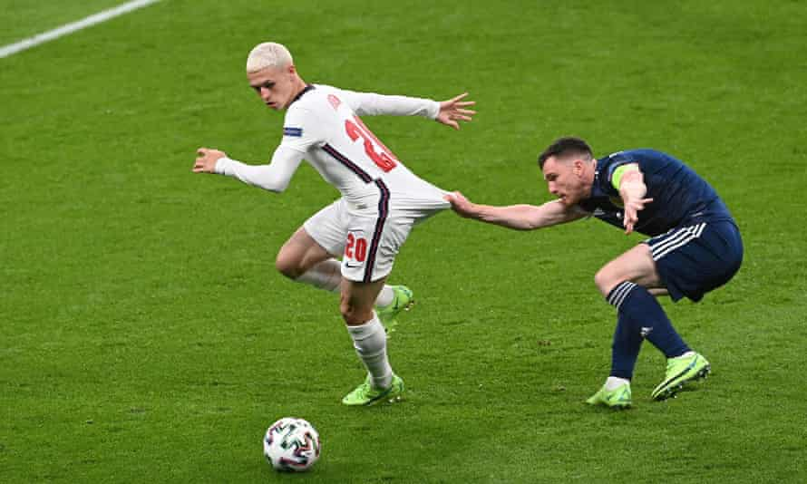 Phil Foden was largely kept out of the game by Scotland's Andy Robertson.