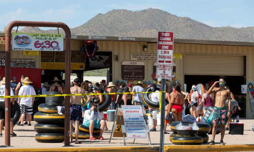 People prepare to go tubing on Salt River in Arizona. About half of Arizona's almost 80,000 cases fall into the 20-44-year-old age bracket.