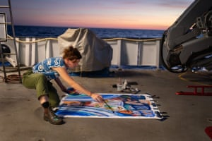 As the sun sunk into the Timor Sea, artist Ellie Hannon from Newcastle, Australia, worked on one of her paintings on R/V Falkor's back deck. Ellie explores the themes and values, possessions and people's relationship with the environment, researching and investigating how our interactions with the natural environment shape our personal and collective identities. On all research expeditions, the Schmidt Ocean Institute invites artists to join the trip and create art in response to the research taking place.
