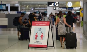 Health advice noticeboards are seen at Sydney airport