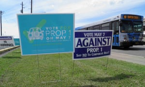 Campaign signs concerning a municipal vote over fingerprint requirements for ride-hailing companies such as Uber and Lyft are seen along a roadway in Austin, Texas, May 6, 2016.