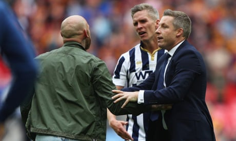 Millwall fans invade Wembley pitch after play-off win over Bradford – video