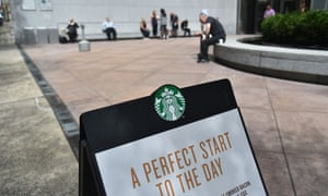 A sign for Starbucks is seen on a street in New York City. A video to be shown to staff reportedly features the chief executive, Kevin Johnson, saying: 'Prejudice in public accommodation is deeply rooted in America.'
