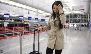 Anastasia Lin walks away from the airline counter after she was denied entry to mainland China.