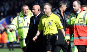 Jonathan Moss is escorted off the pitch after the 2-2 draw between Leicester City and West Ham.