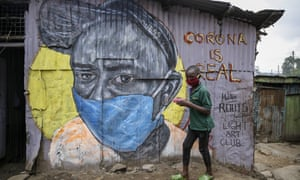 A boy wearing a face mask in the Mathare slum of Nairobi, Kenya.