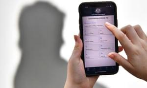 A person using the Australian government's coronavirus app