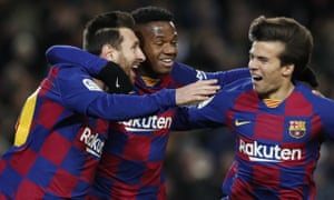 Barcelona's Lionel Messi, celebrates with Ansu Fati and Riqui Puig after his winner against Granada.