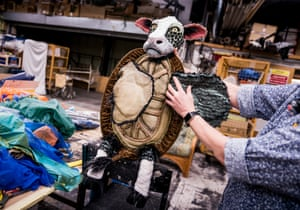 A member of the props team with the Mock Turtle.