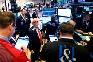 Traders on the floor of the New York Stock Exchange (NYSE) today