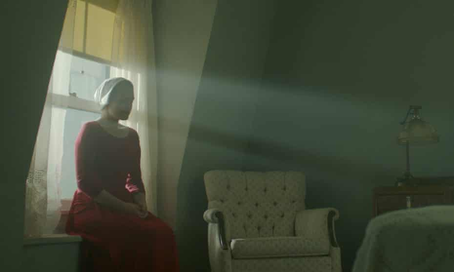 'It has the slow, creeping dread of a horror movie, made all the more disquieting by the blood-red cloaks and the insistent and ominous score that pulses throughout' ... Elisabeth Moss in The Handmaid's Tale.