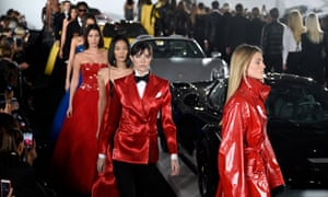 Models navigate their way around the cars on the Ralph Lauren catwalk