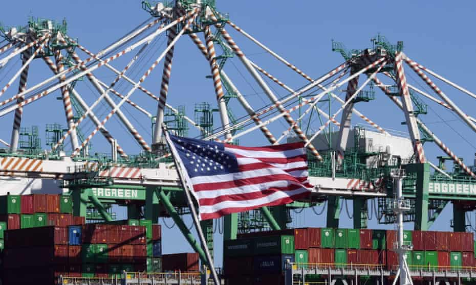 Shipping containers from China and other countries are unloaded at the Long Beach Port in California last month. US economic growth was revised sharply lower for the final three months of 2018.