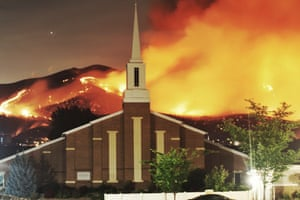 The Traverse Fire burns near homes in Lehi, Utah, in June.