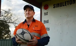 Steve Merrick stands in front of the scoreboard at Rugby Park in Singleton, two hours drive north of Sydney.