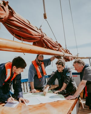 From left to right, Patrick Barkham, Charlie Hodson, skipper Dom and a crew member on board the Salford whelk boat off the north Norfolk coast.