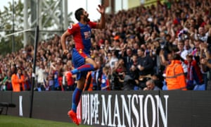 James Tomkins celebrates scoring his side's first goal on his full Premier League debut for Crystal Palace.