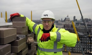 Sir Nicholas Serota laying the last brick in the extension of the Tate Modern in February.