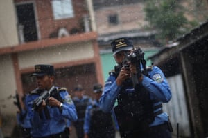 Police patrol in a neighbourhood occupied by gangs in Tegucigalpa