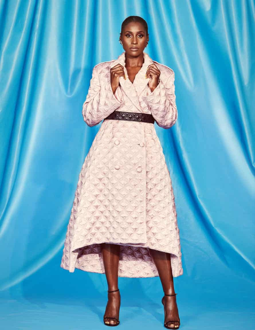 Issa Rae in a belted pale pink coat dress