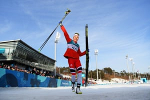 Norway's Ragnhild Haga celebrates after winning the women's 10km cross-country.