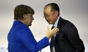 World Bank president Jim Yong Kim with German chancellor Angela Merkel in Paris.