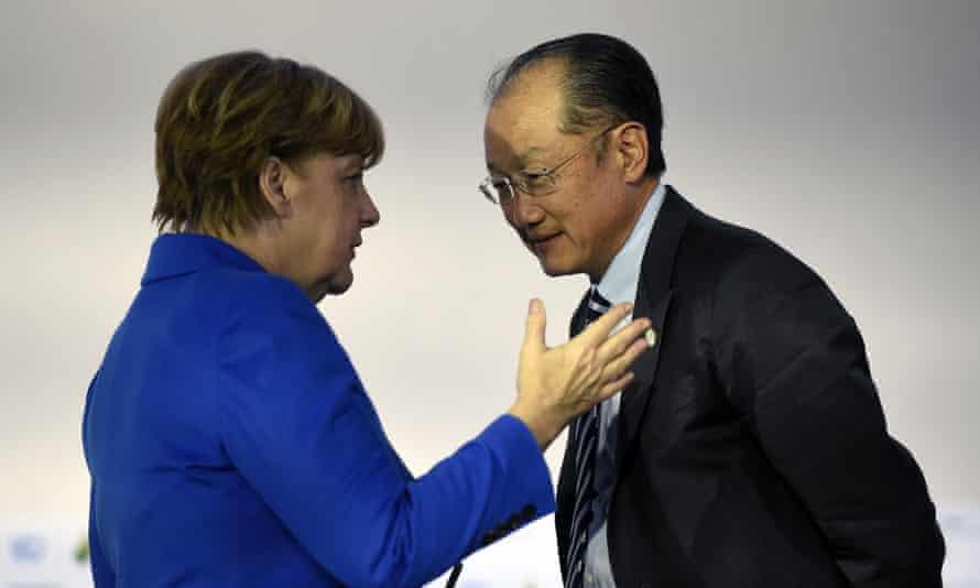 World Bank president Jim Yong Kim with German chancellor Angela Merkel in Paris.