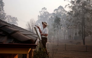 Dale Palmer prepares his property, which is nestled into the Khappinghat nature reserve south of Taree
