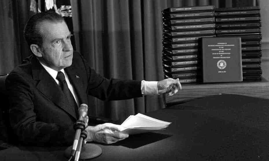 Richard Nixon points to the transcripts of the White House tapes, in April 1974.