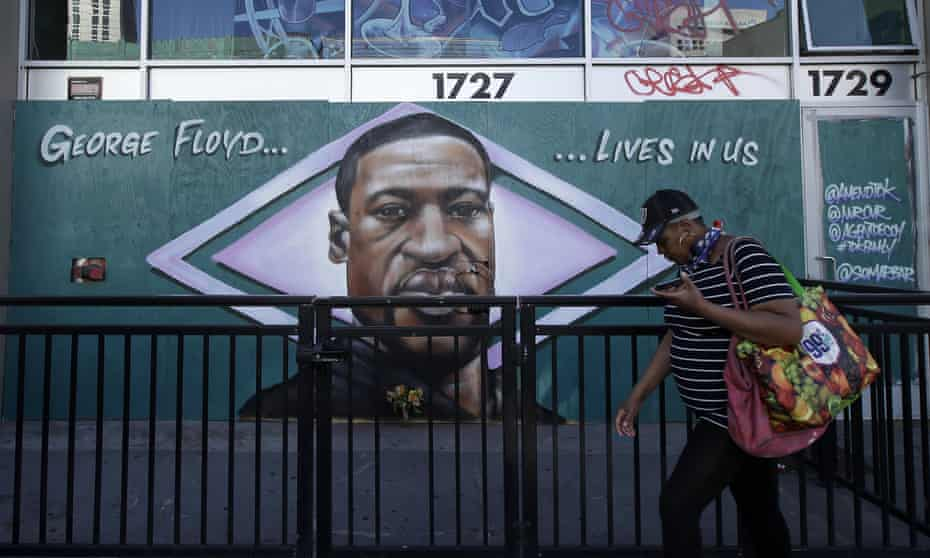 A person walks past a mural of George Floyd in Oakland, California, Thursday, 4 June 2020.