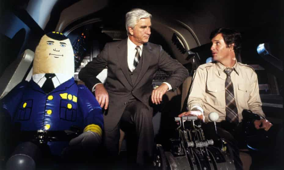 Leslie Nielsen and Robert Hays in Airplane!, a film that never pauses for a laugh, because there's another one coming.