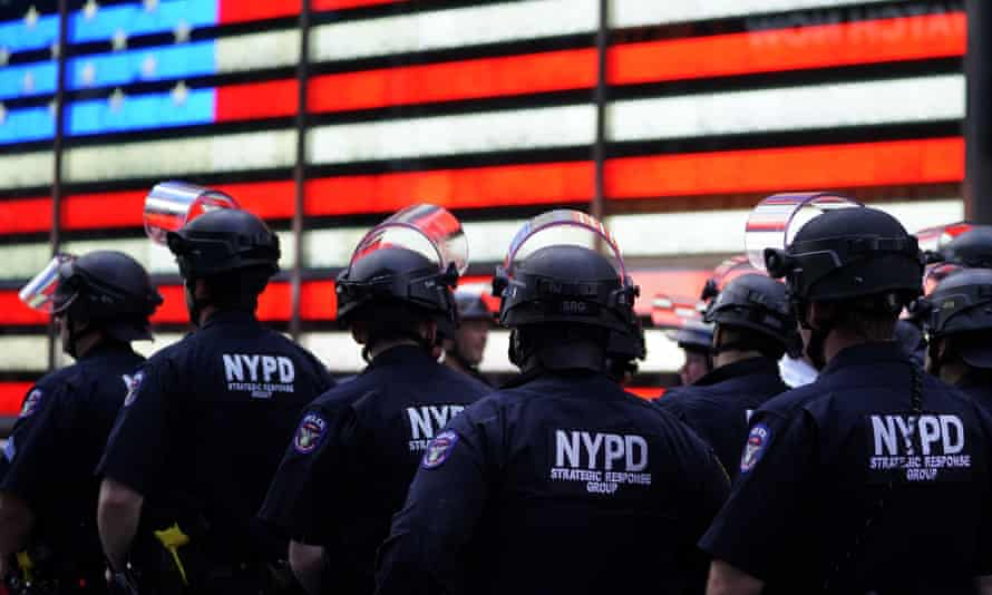 Police officers watch demonstrators in Times Square on 1 June 2020, during a Black Lives Matter protest.