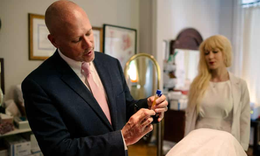 Dr Charles Runels shows the PRP (platelet-rich plasma) to a patient, which comes from the blood of the patient themselves and is the secret behind the O-Shot.