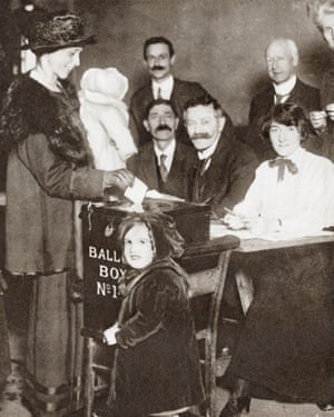A British woman voting for the first time in the 1918 general election.