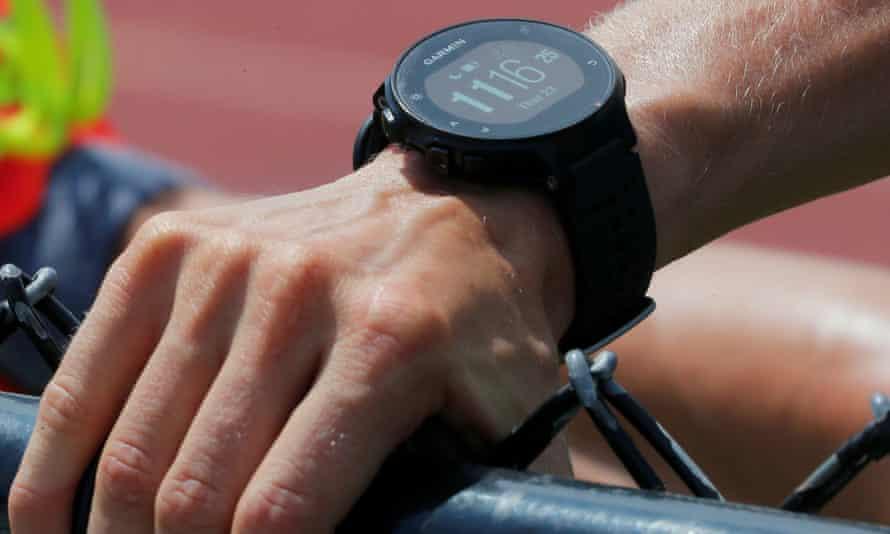 A runner wearing a Garmin smartwatch