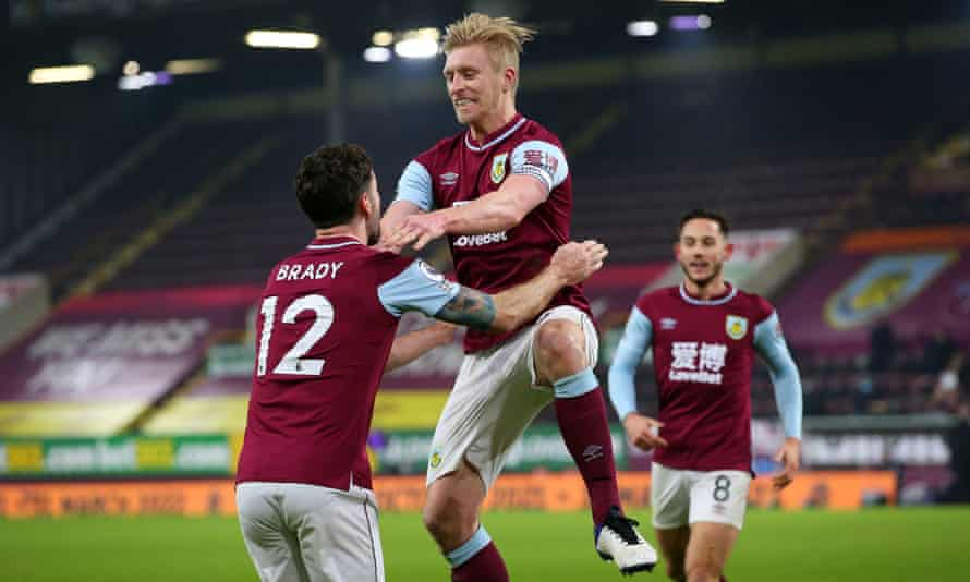 Burnley's Ben Mee leaps into Robbie Brady's arms (centre) after scoring the winner against Sheffield United.